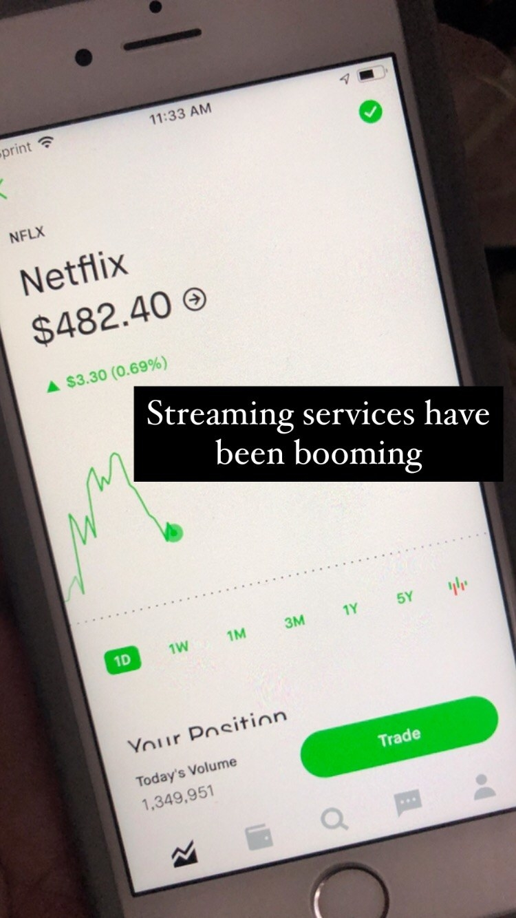 """Me holding my phone showing the stock price of Netflix at $482.40; text reading """"streaming services have been booming"""""""