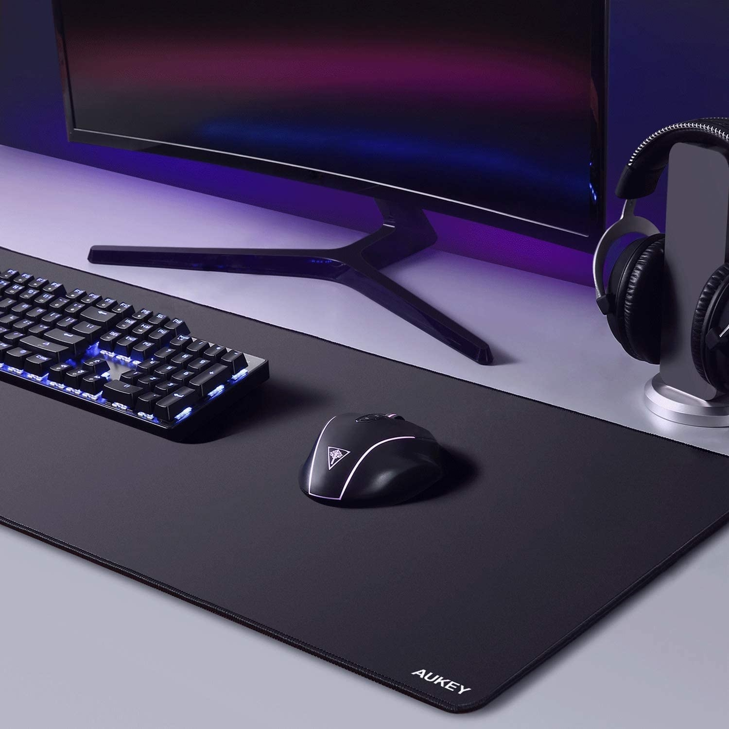 mat with keyboard and mouse on it