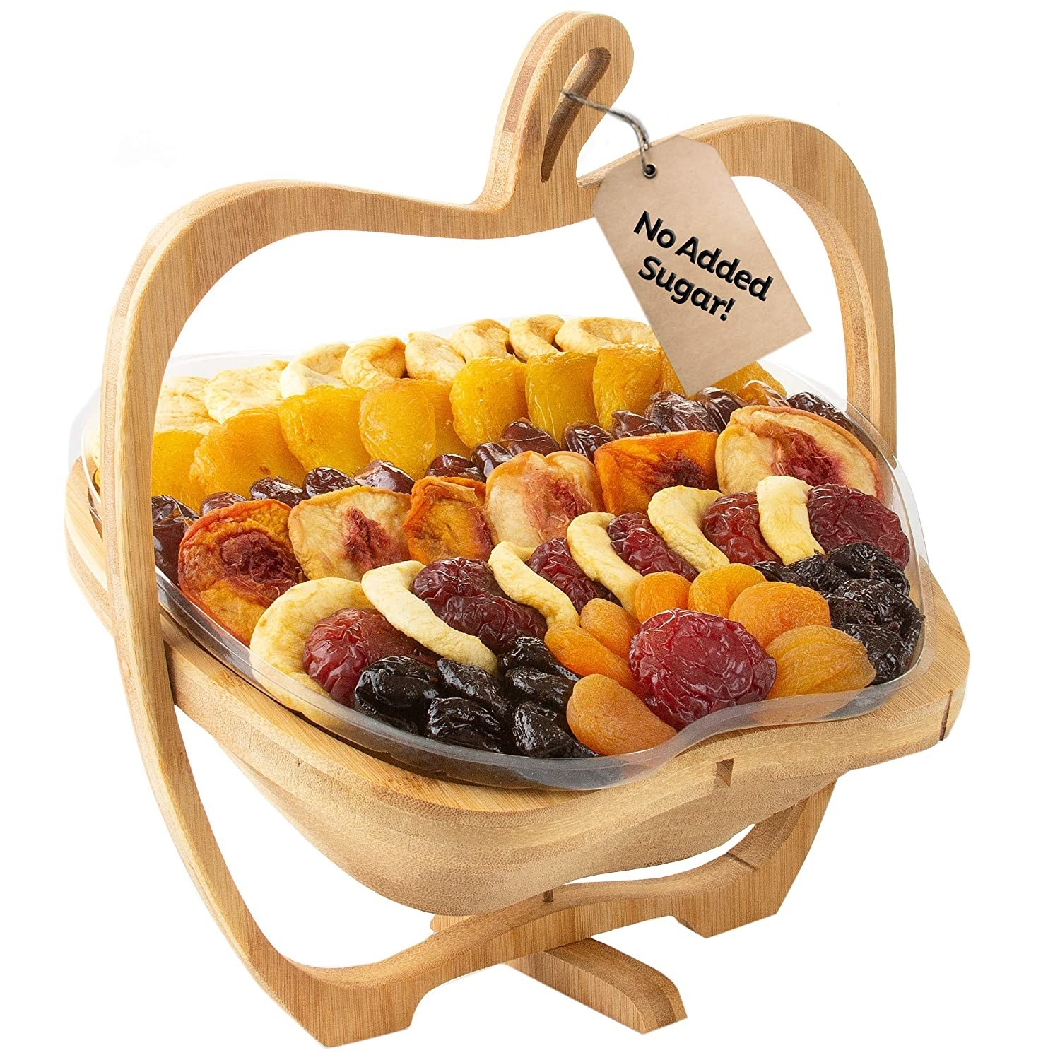apple shape wood display with dried fruits in it
