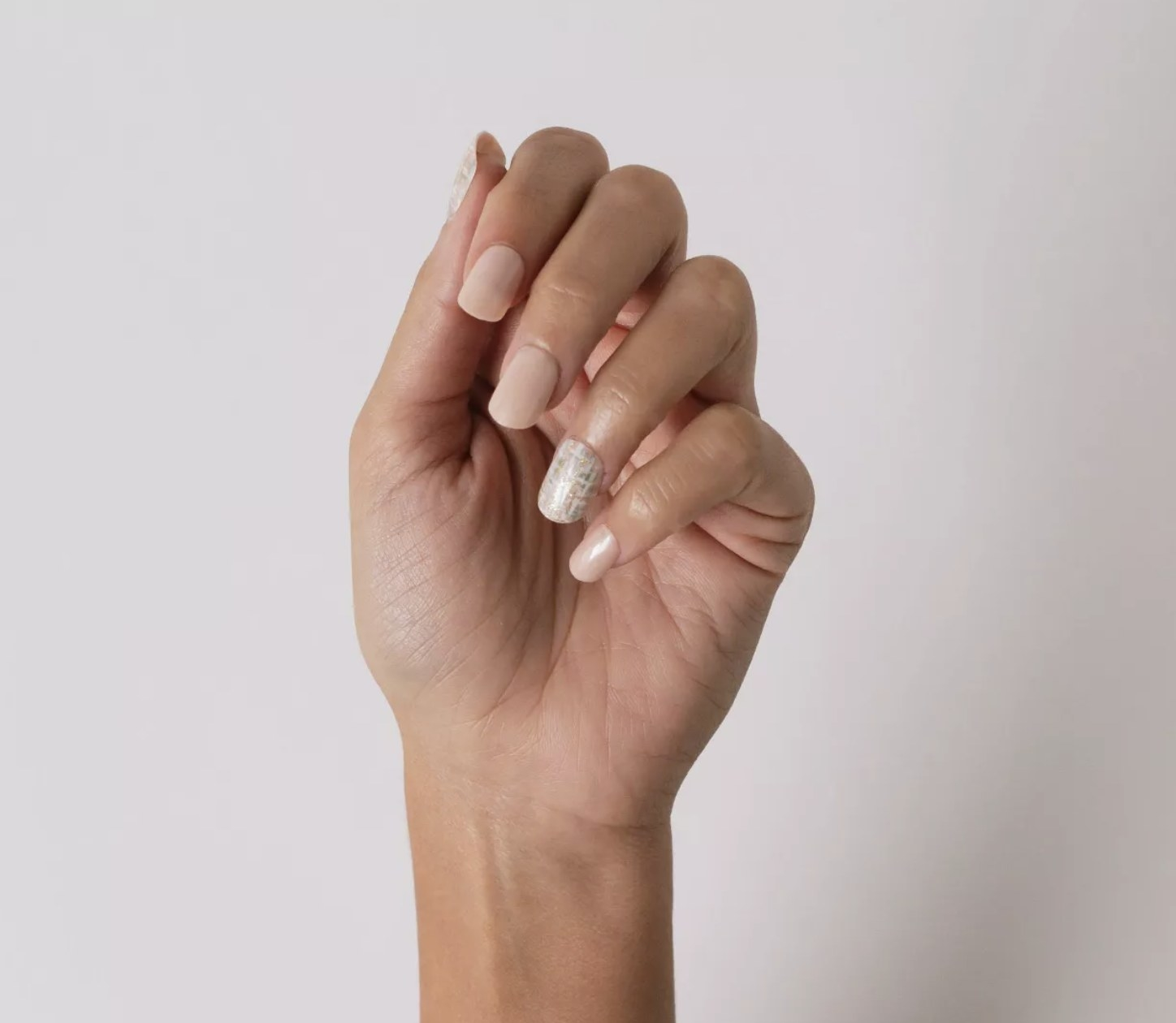 Person is showing their fake nails
