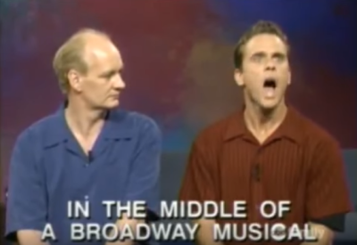 """Colin and Chip with text reading, """"In the middle of a Broadway Musical"""""""