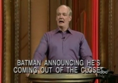 """Colin at a podium with text reading, """"Batman announcing he's coming out of the closet"""""""