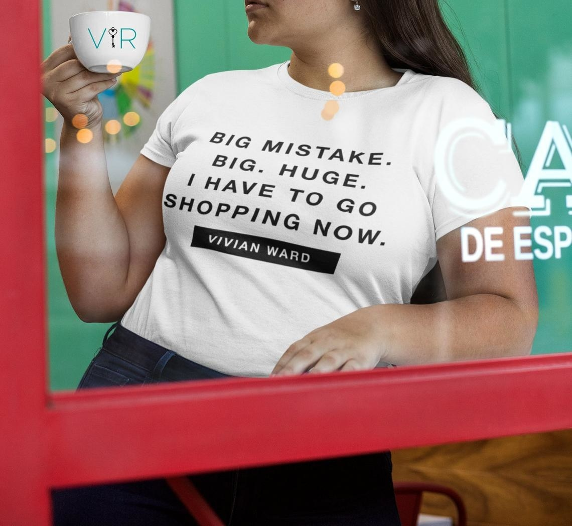 "A model wearing the white short sleeve tee that reads ""Big mistake. Big. Huge. I have to go shopping now. Vivian Ward"""