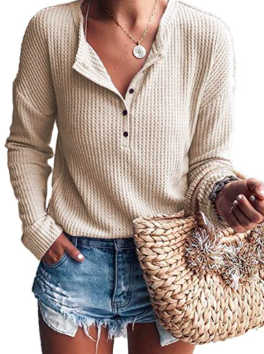 A person wearing the waffle henley with a pair of shorts
