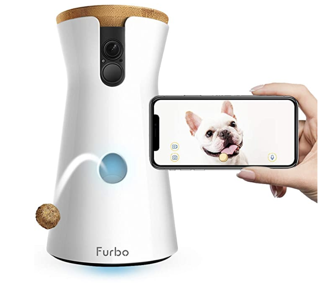 A cylindrical product with a treat dispenser and a dog displayed on a phone screen