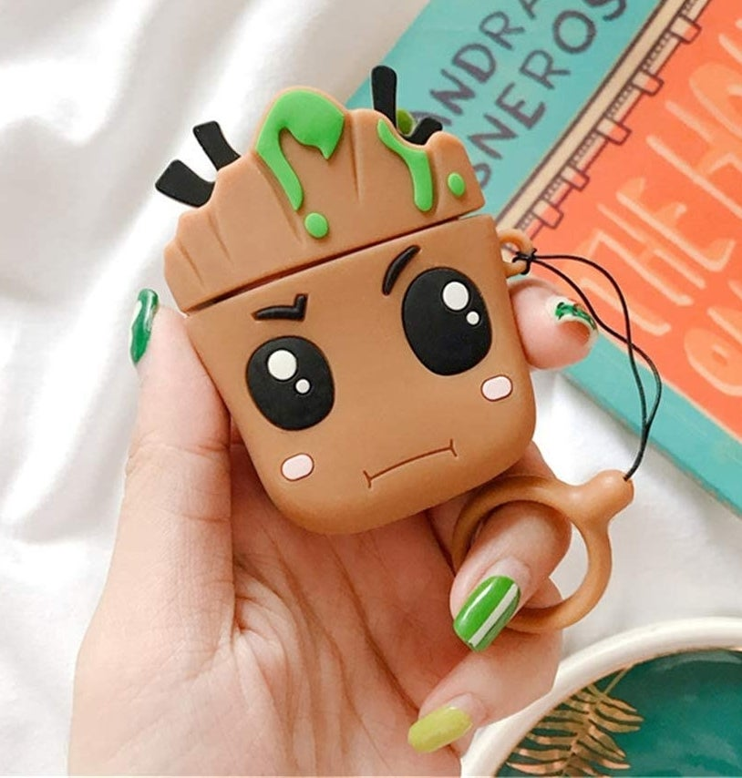 A person holding the Groot case