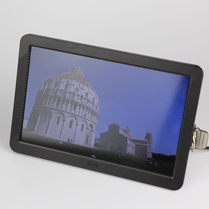 Reviewer photo of digital picture frame on table