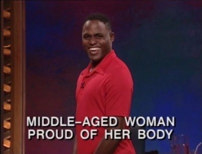 """Wayne looking VERY goofy with text reading, """"Middle-aged woman proud of her body"""""""