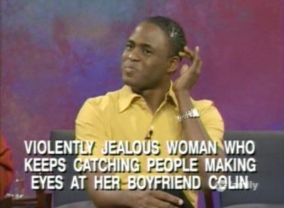 """Wayne sitting pretty with text reading """"Violently jealous woman who keeps catching people making eyes at her boyfriend, Colin"""""""