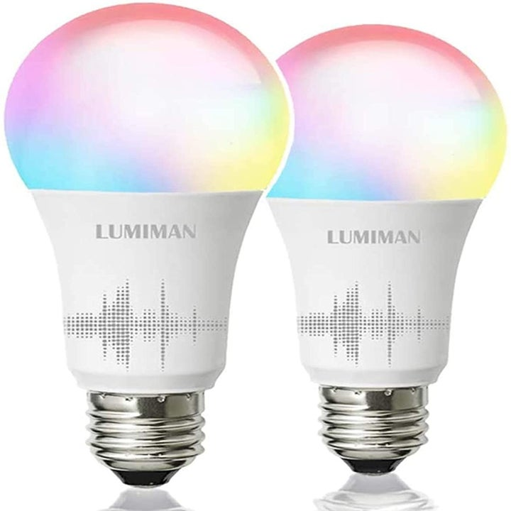 A pair of Lumiman lightbulbs with a metallic screw base and multicolored top to show the various light color capabilities