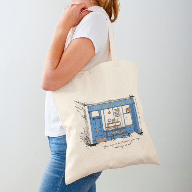 The canvas tote with a sketch of the blue bookshop