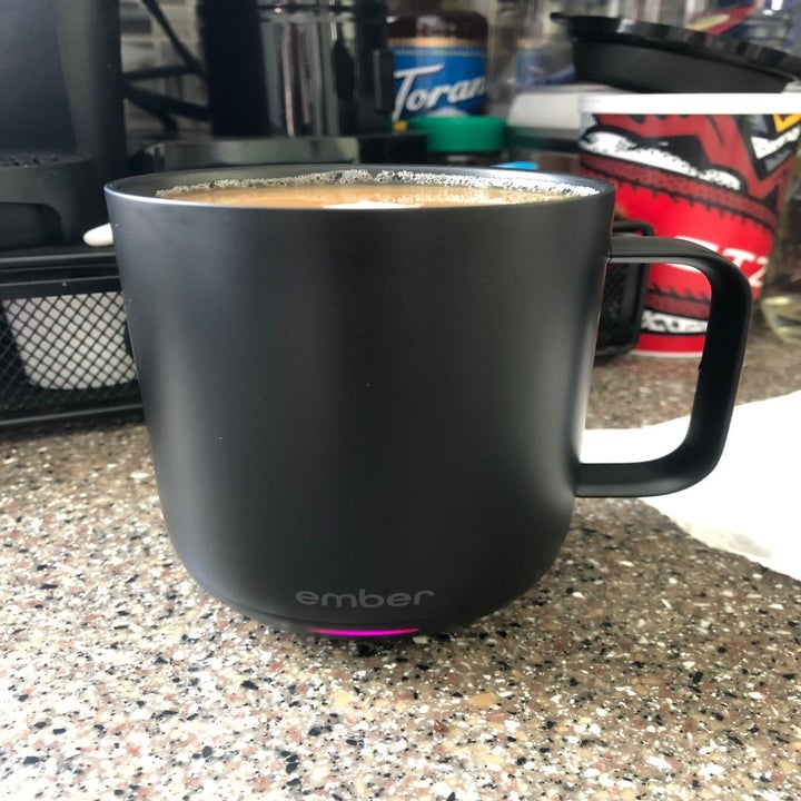 Reviewer photo of black Ember mug filled with coffee
