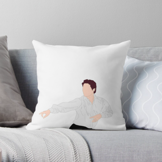 "The square white pillow with a silhouette of Hugh Grant in ""Love, Actually"" pointing his fingers and dancing"