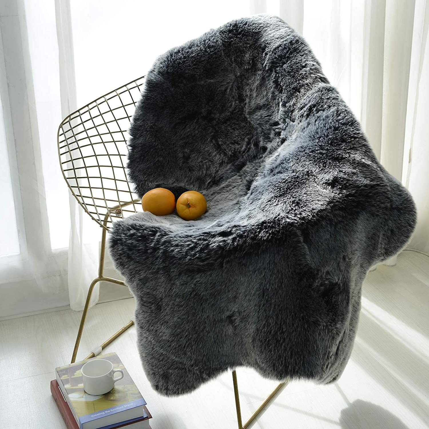 A faux fur rug draped over a wire framed armchair