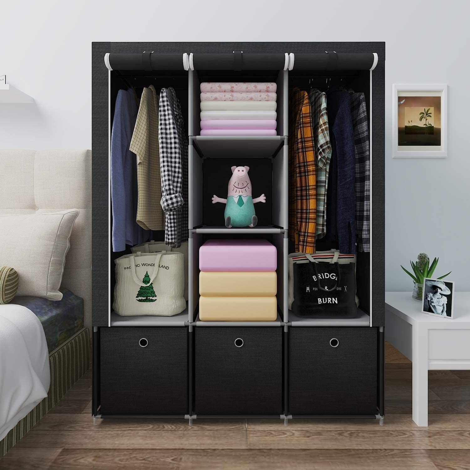 the ghqme fabric wardrobe storing clothes in a decorated bedroom