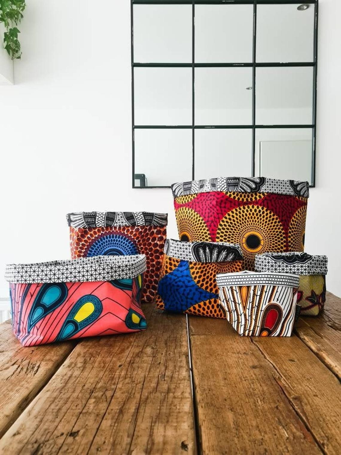 The fabric baskets with colorful fabric on the outside and black and white fabric on the inside