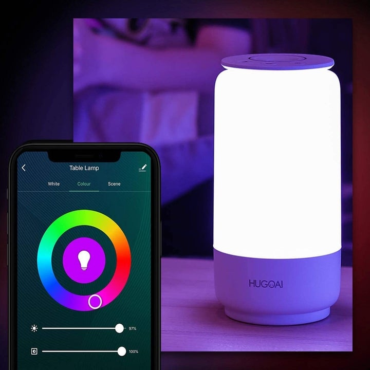Smartphone with accompanying app in front of smart lamp
