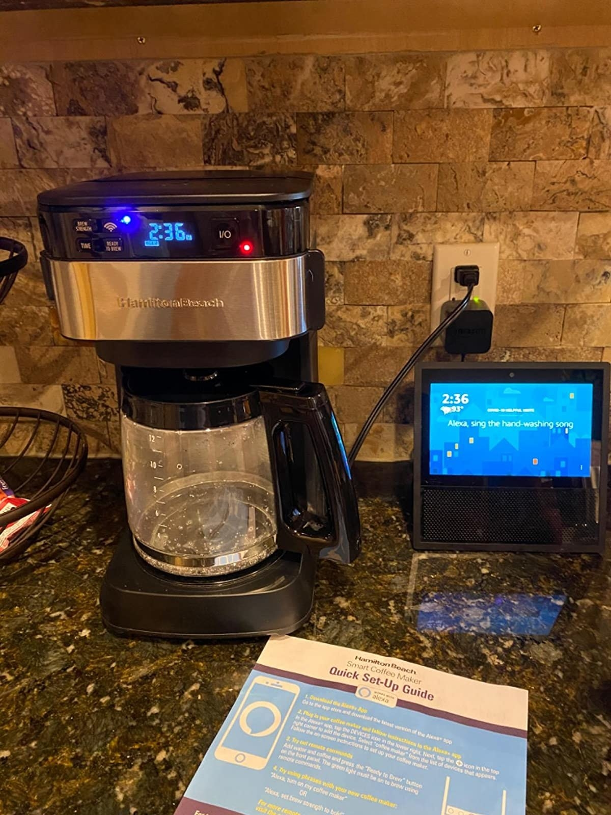 Reviewer photo of coffee maker on kitchen counter next to an Alexa-enabled device