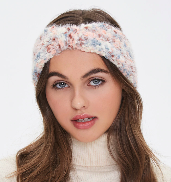 model wearing the white, pink, and blue headwrap