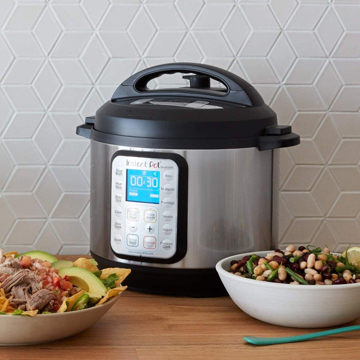 Instant Pot on table with bowls of food