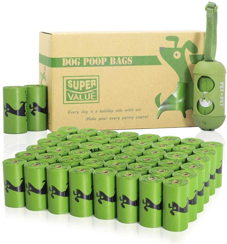 A large amount of green poop bags