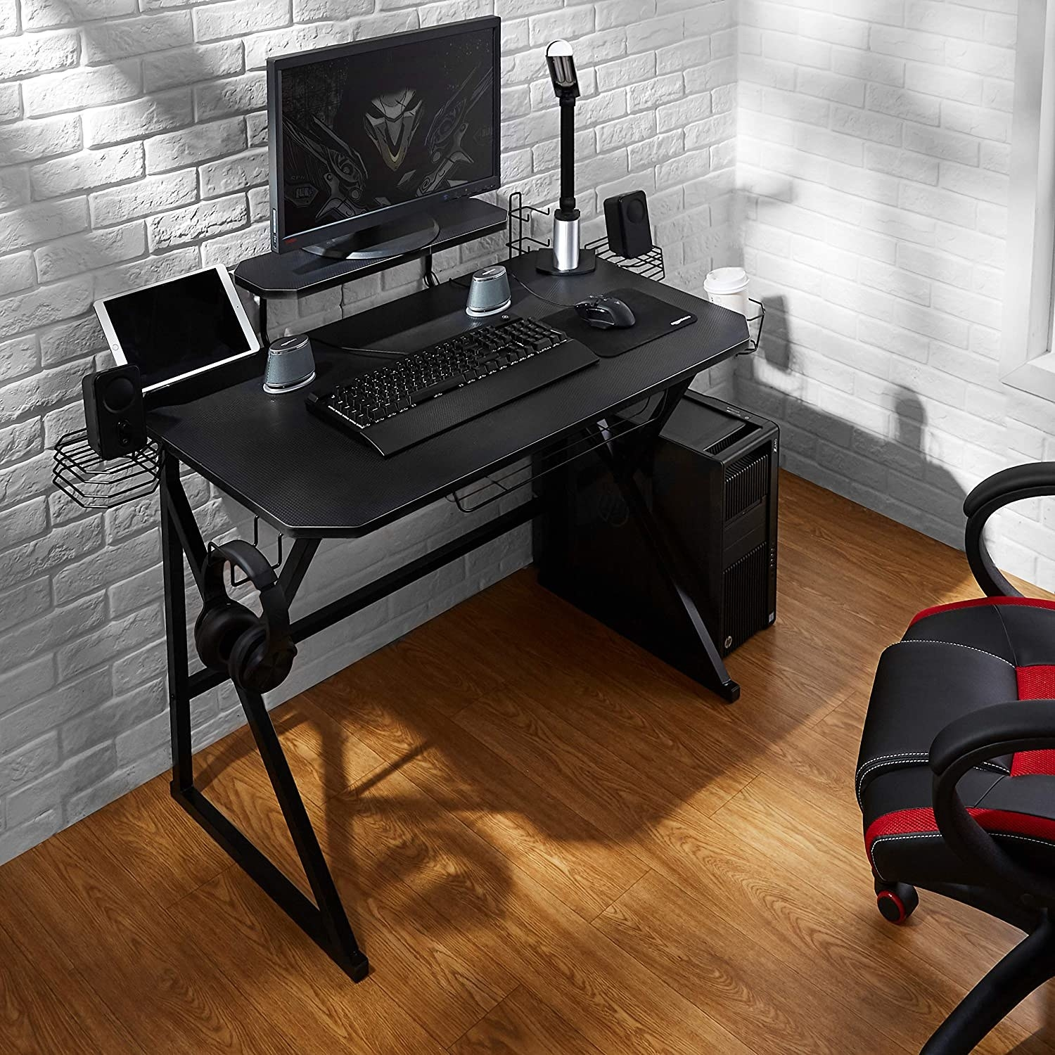 desk with computer, headset, and other accessories