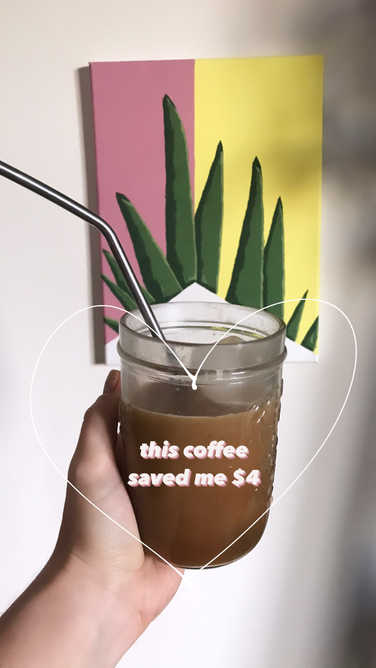 "A hand holds up a mason jar of coffee encircled in a drawn heart and text ""this coffee saved me $4"""
