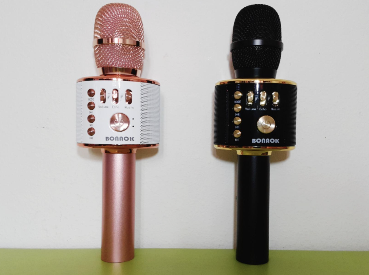 reviewer image of two mics (black and pink) standing next to each other