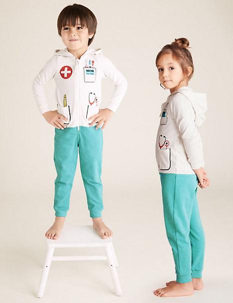 two children in the onesies that look like a doctor wearing scrubs