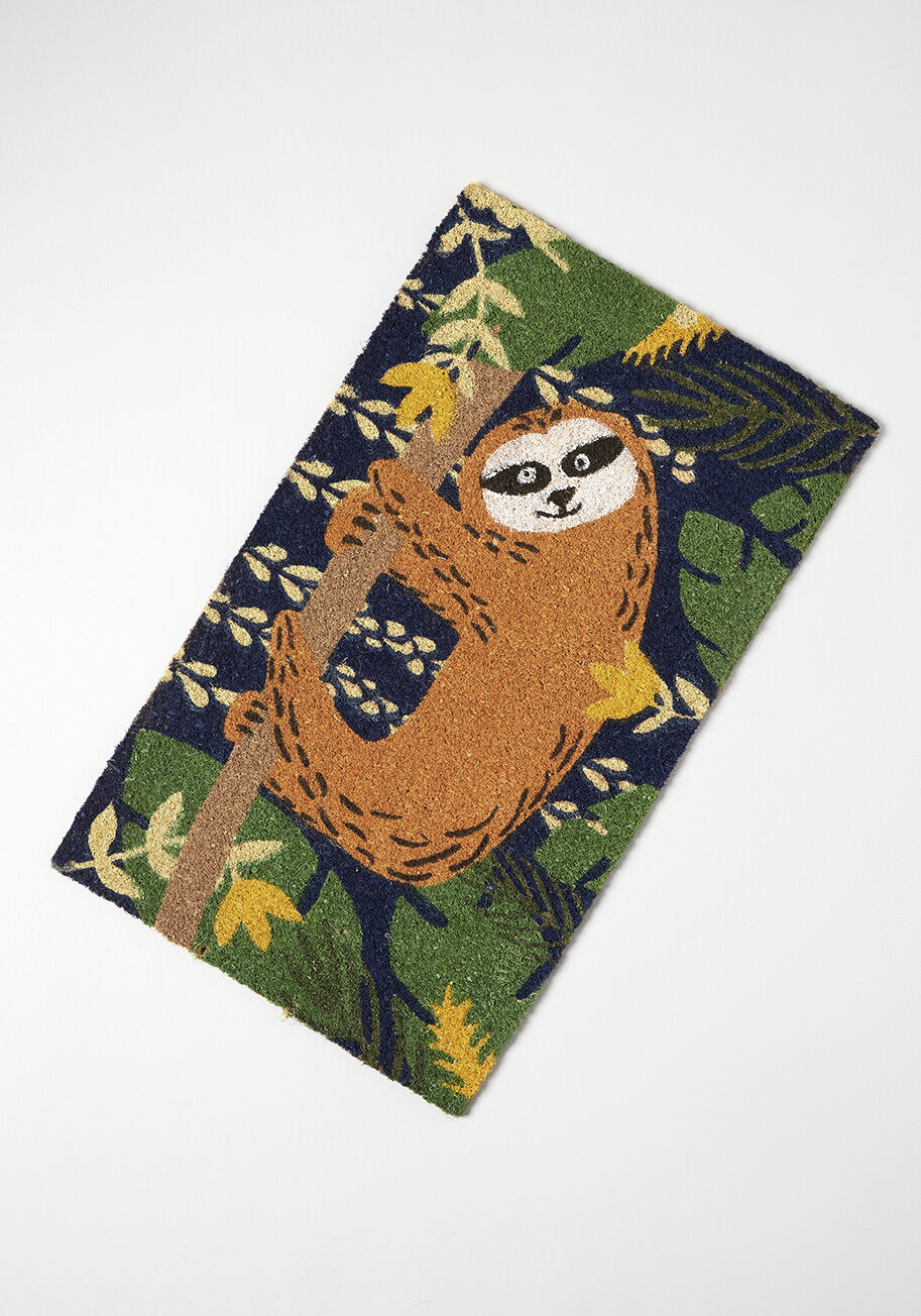 The brown sloth hanging on a tree against a blue jungle background