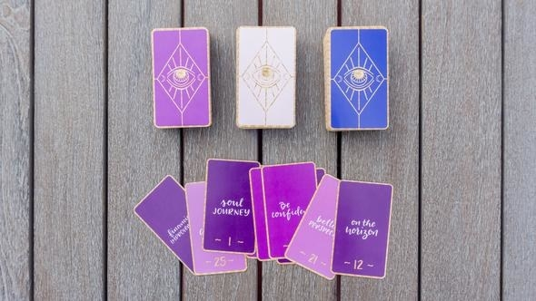 the cards with script text on one side and illustrated eyes on the other
