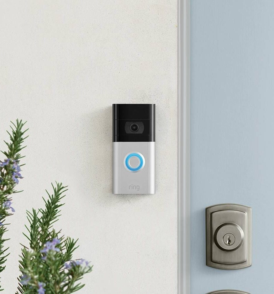 The Ring doorbell attached to the side of a door