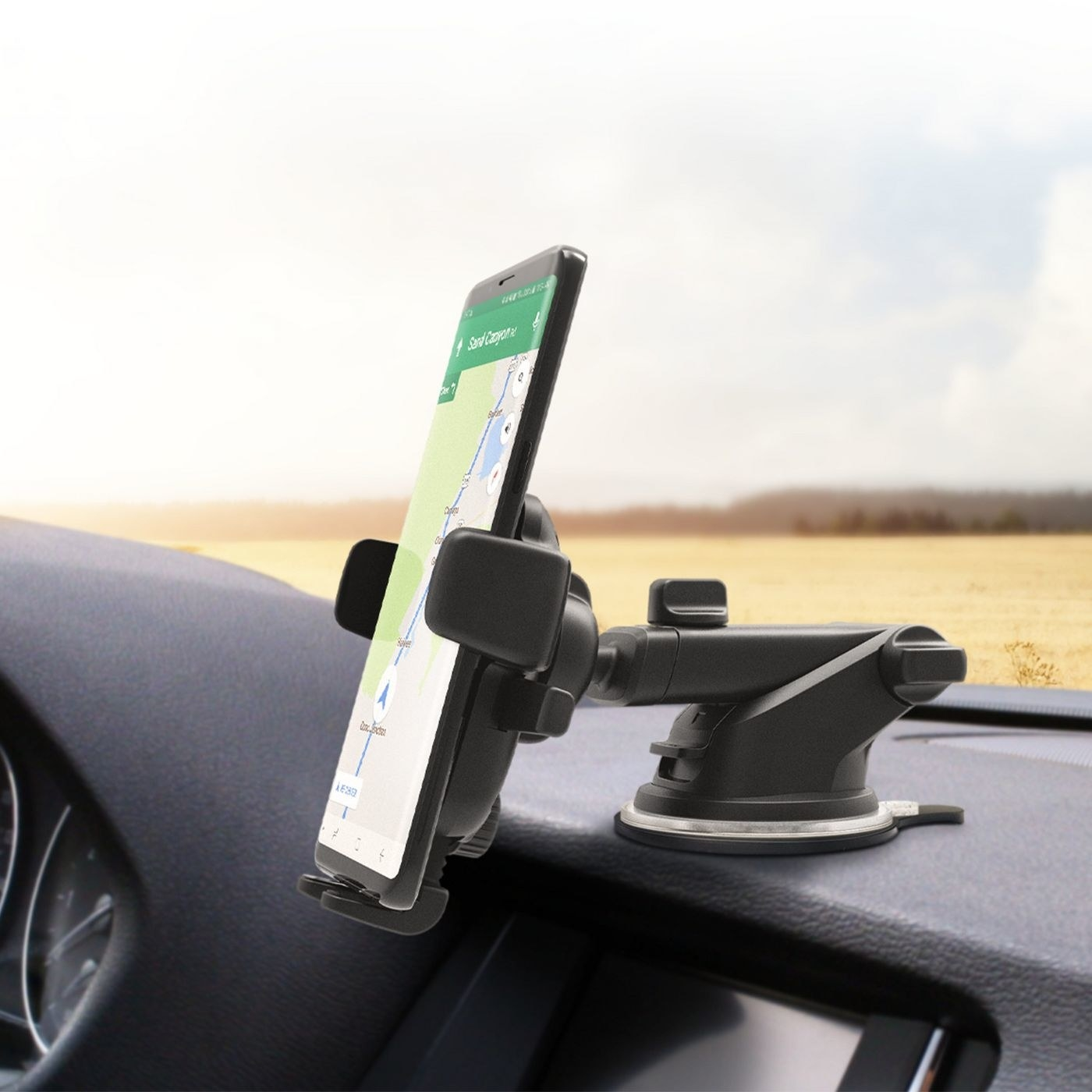 The mount placed on the dashboard of a car holding a smartphone