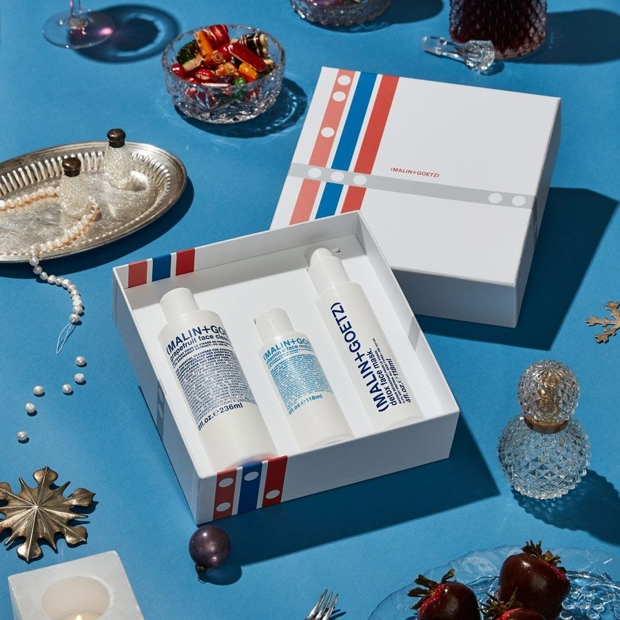 the skincare set styled on a table with holiday decor