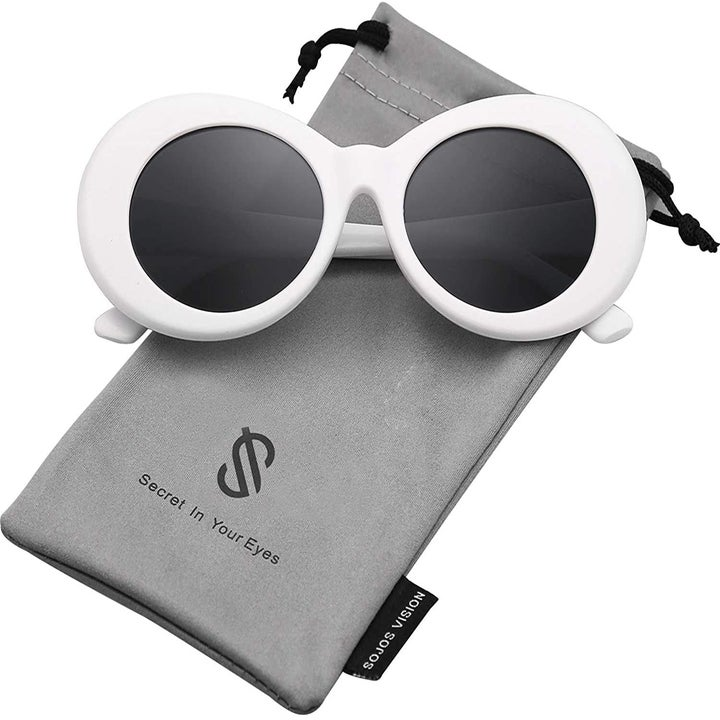 The oval shaped white sunglasses with black lenses