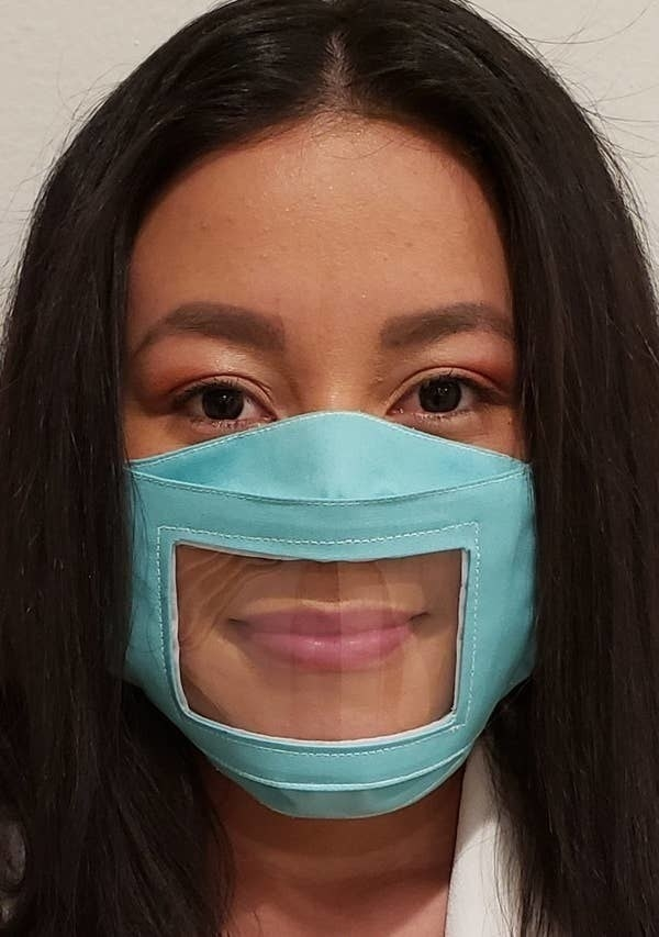 A person wearing the clear panel non-medical face mask in light blue