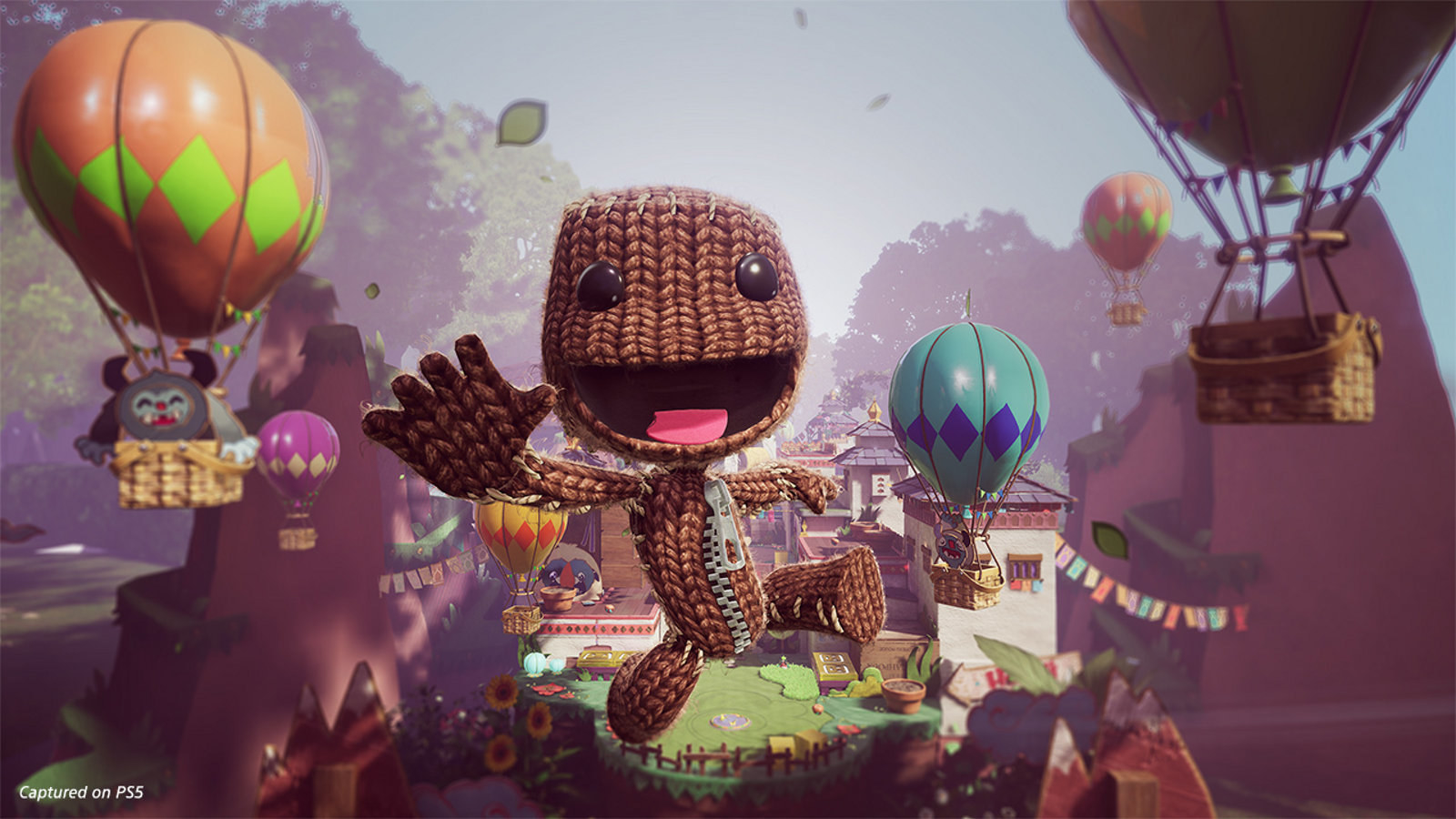 An adorable little knit character jumps excitedly through an animated world and surrounded by hot air balloons
