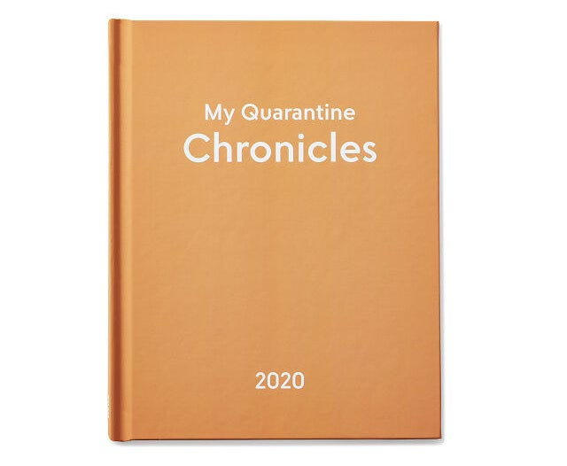 "the orange/tannish book with white text reading ""my quarantine chronicles 2020"" in white on the cover"