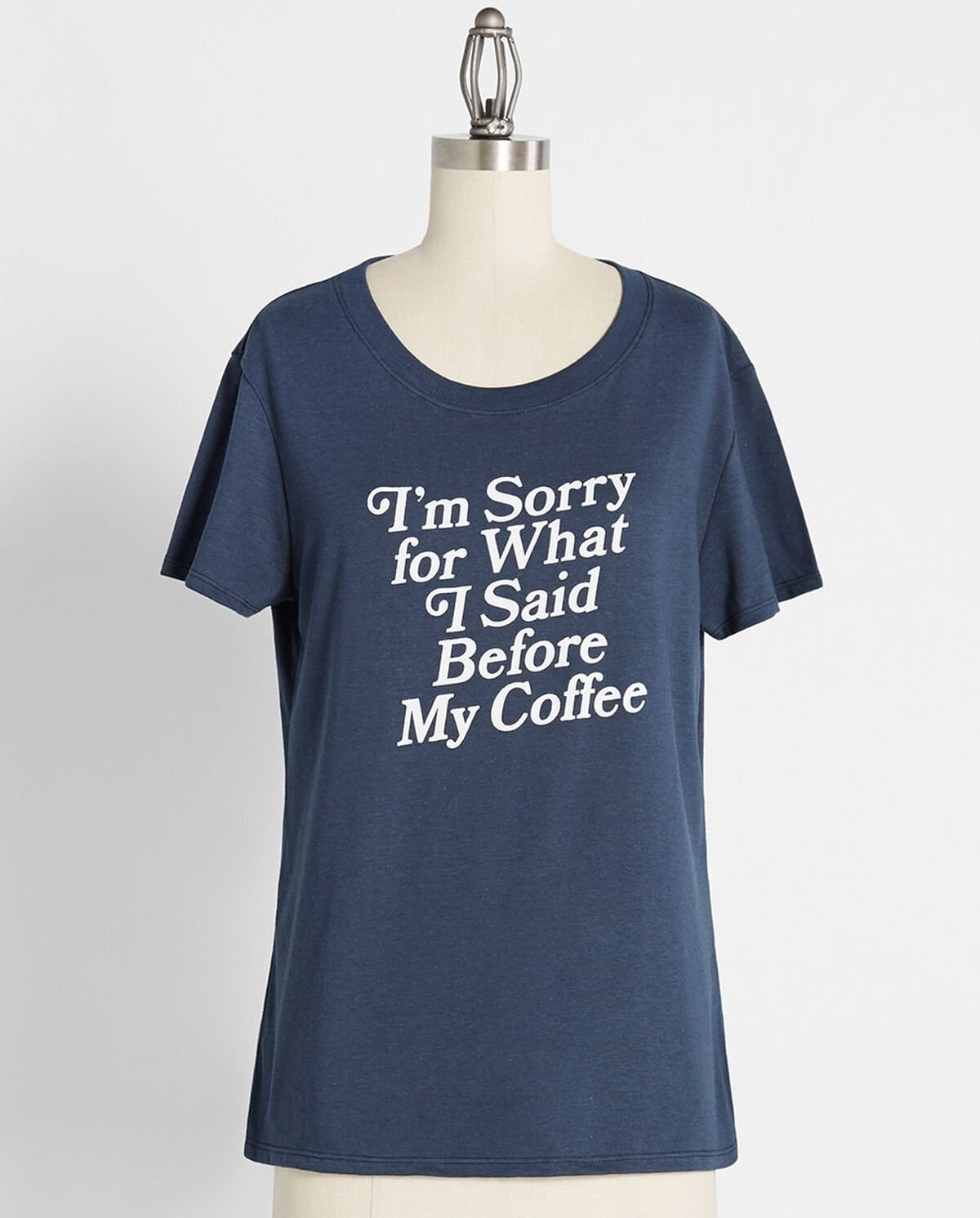 """the blue shirt that reads """"i'm sorry for what I said before my coffee"""" in white text"""