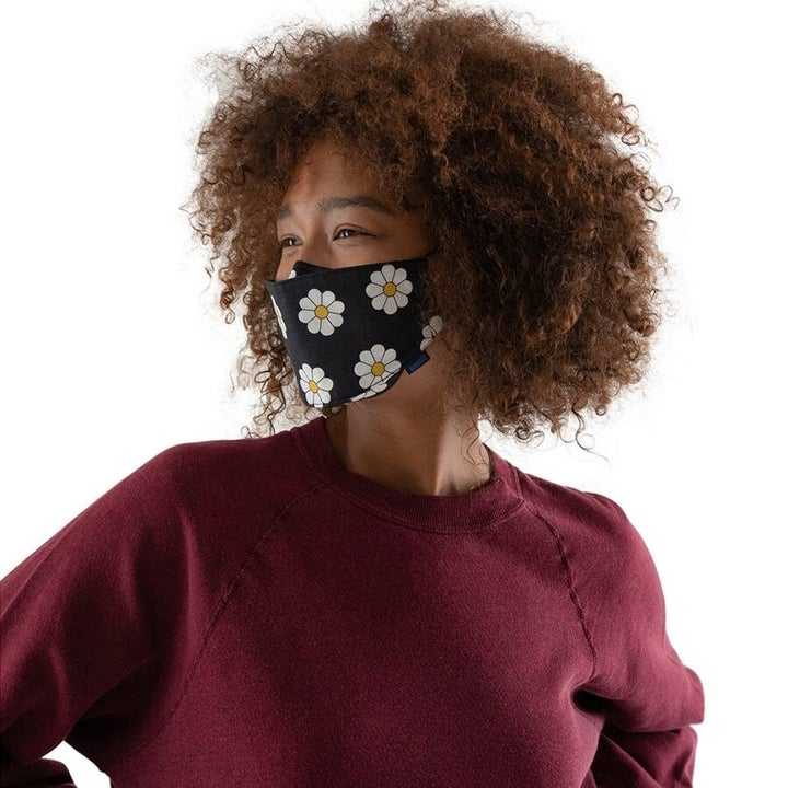 a model wearing a floral print mask