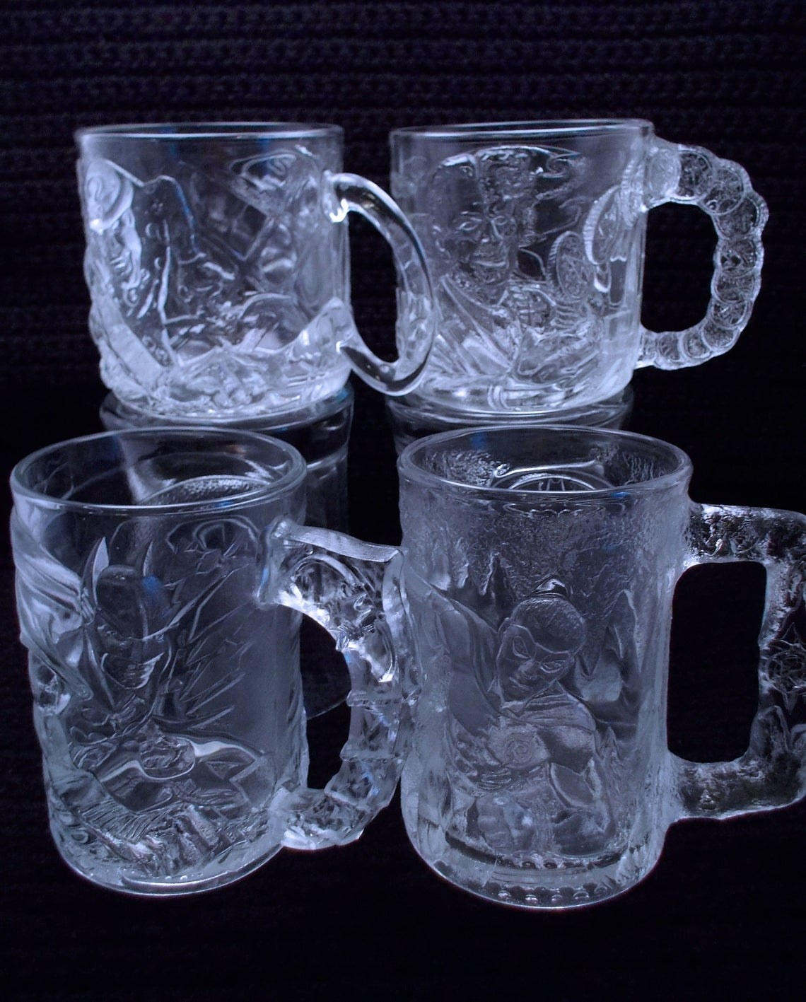 "A set of four ""Batman Forever"" glasses from McDonald's."