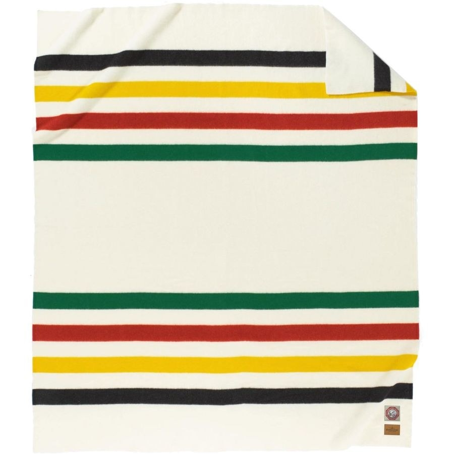cream blanket with green, red, yellow, and black stripes