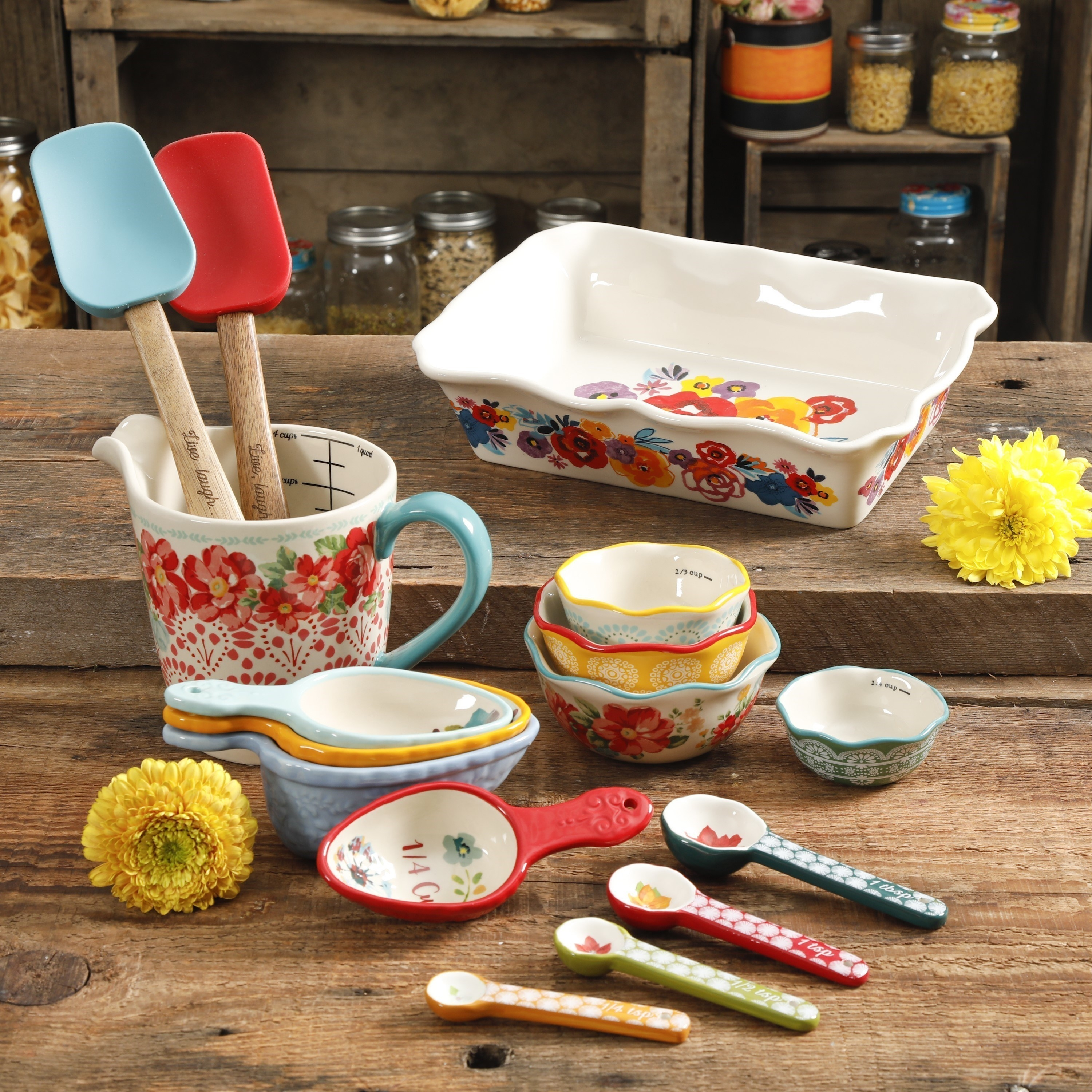the floral baking set displayed in a kitchen with two yellow flowers