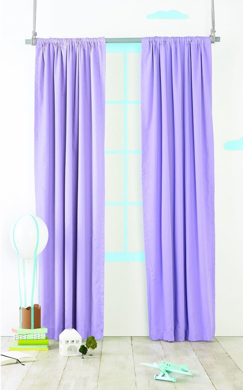 The curtains, which hang all the way to the floor