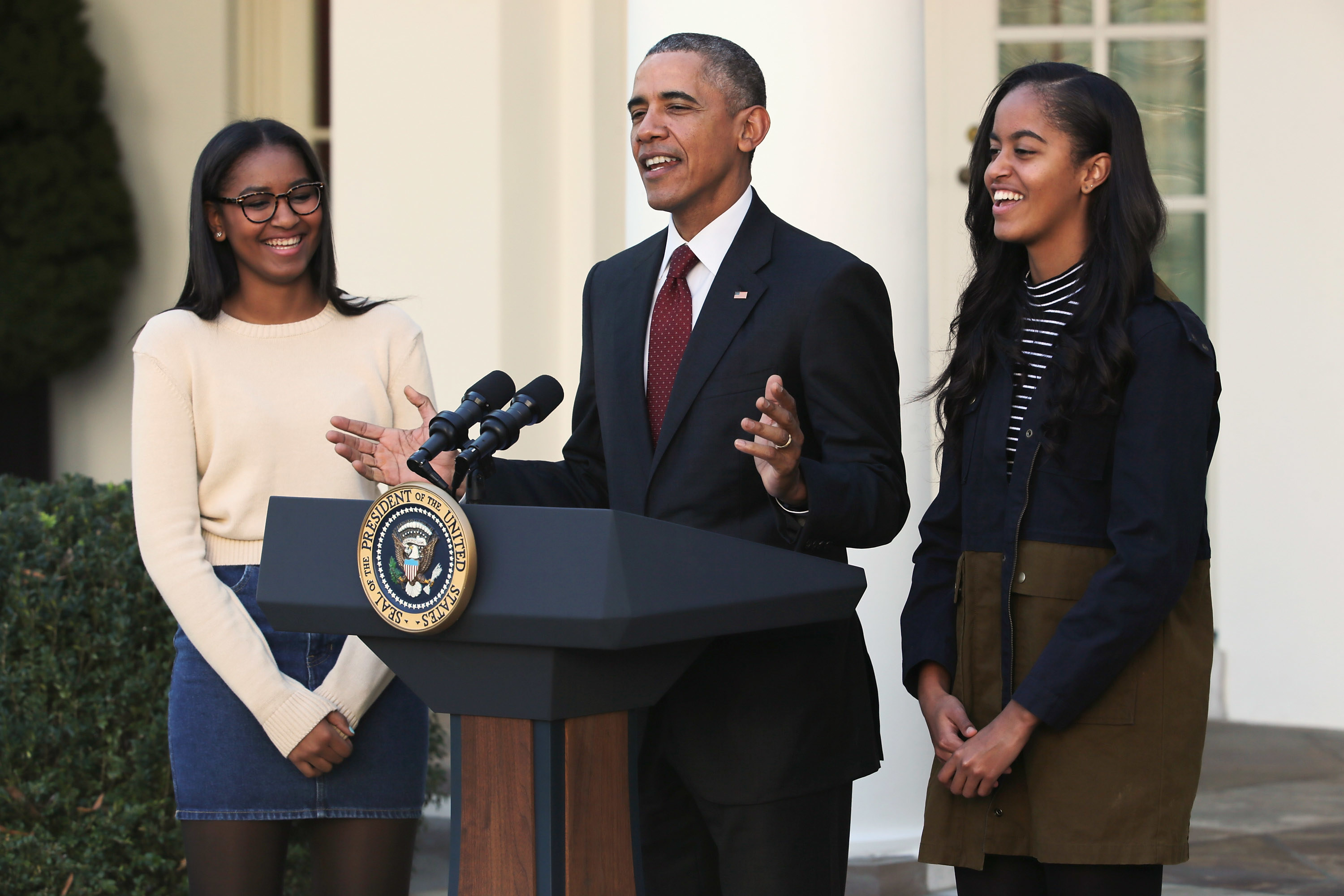President Obama delivers remarks with his daughters Sasha and Malia during the annual turkey pardoning ceremony in 2015