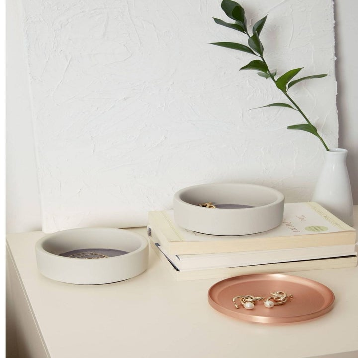 The kit in three separate pieces—two deeper resin jewelry bowls, and a round metal display tray