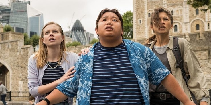 Ned and two other students looking terrified as a super villain wreaks havoc