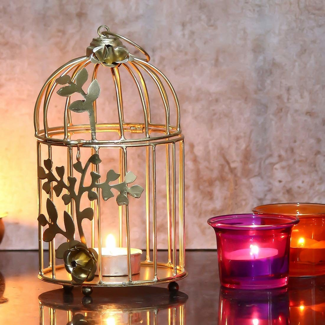 A golden bird cage shaped candle holder.
