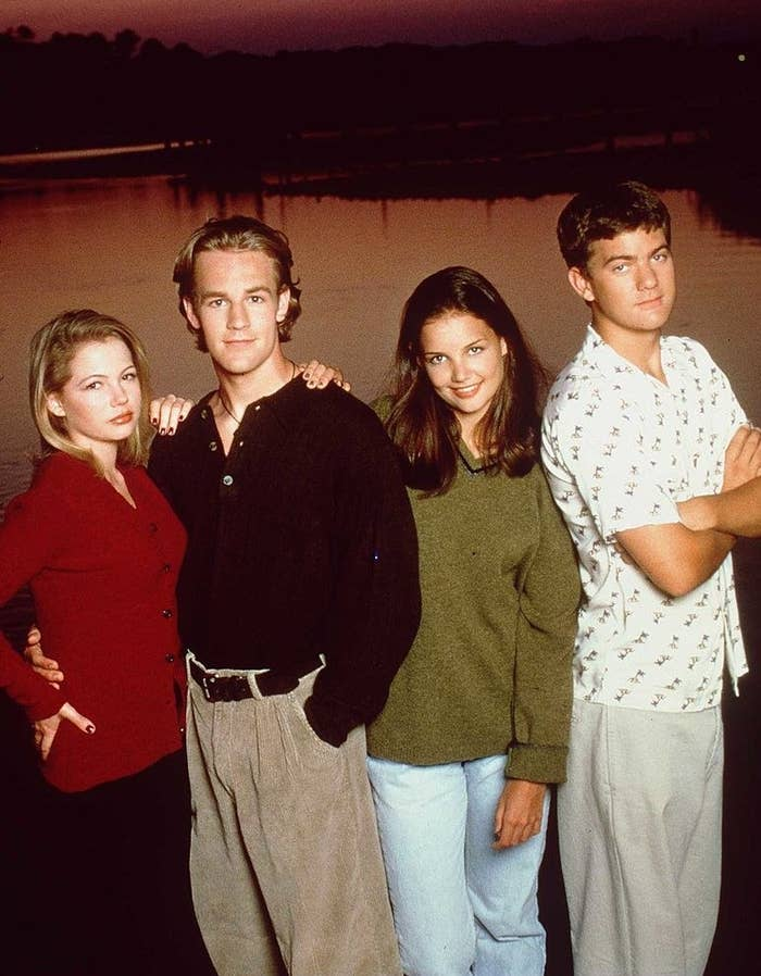 Promo shot of Dawson's Creek; Jen, Dawson, Joey and Pacey stand together in front of the creek