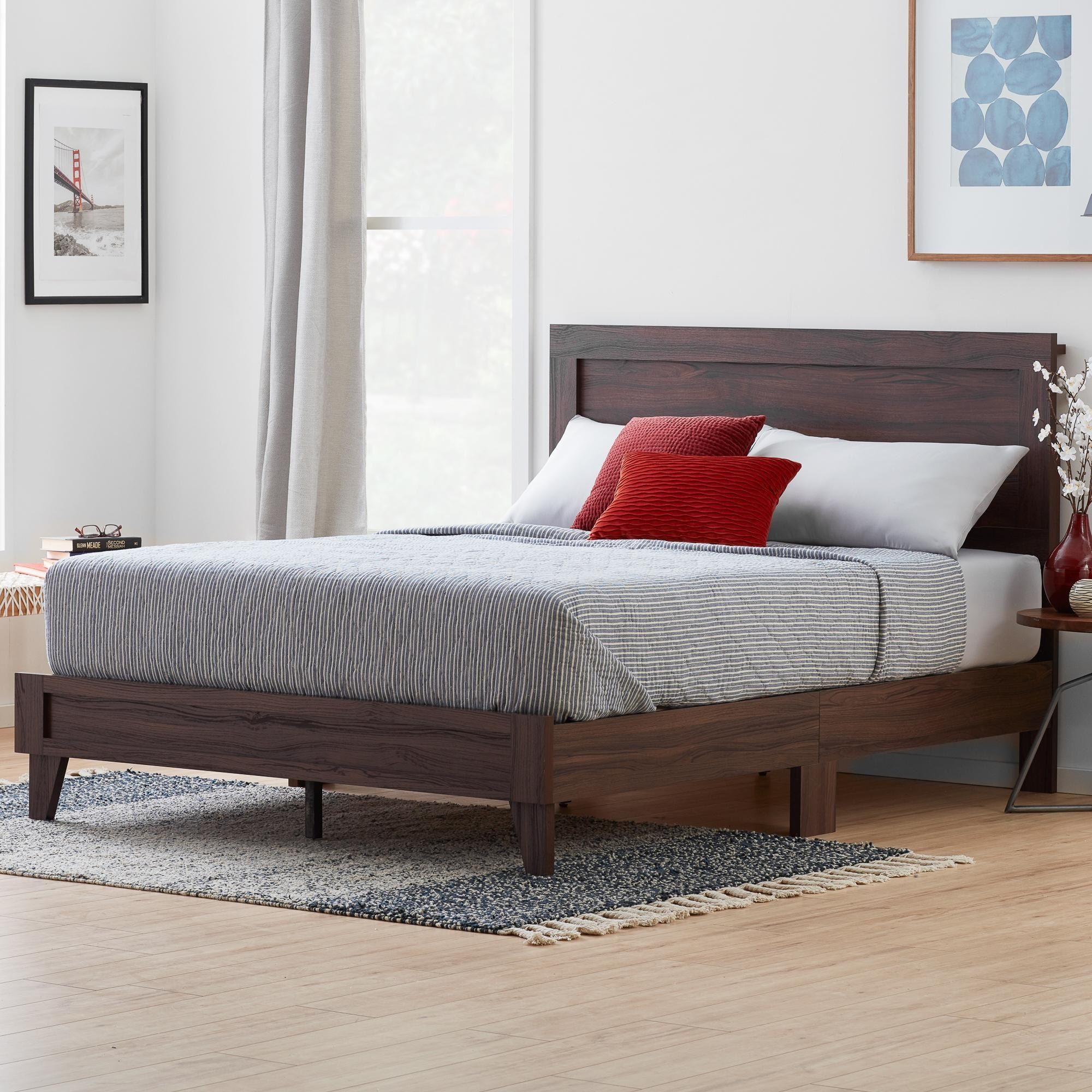 The dark brown bed in a bedroom